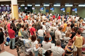 Busy queues at airport check in desk